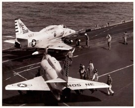 Flight deck crews move two A-4 Skyhawks - US Navy photo, cleared for publication.