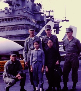 Li Lai Ha and her Marine escorts. - Malcolm R. Campbell photo